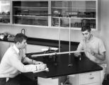 Two Students in the College Lab of the High School Building