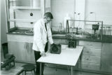 Unidentified science instructor with equipment